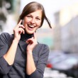 Royalty-Free Stock Photo: Happy young lady talking on mobile phone