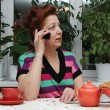 Closeup portrait of senior lady on landline phone call — Stock Photo