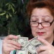 Senior woman counting savings money — Stock Photo