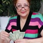 Senior woman counting savings money — Stock Photo