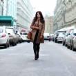 Stock Photo: Beautiful young woman walking on the street