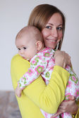 Adorable baby and mother in home — Stock Photo
