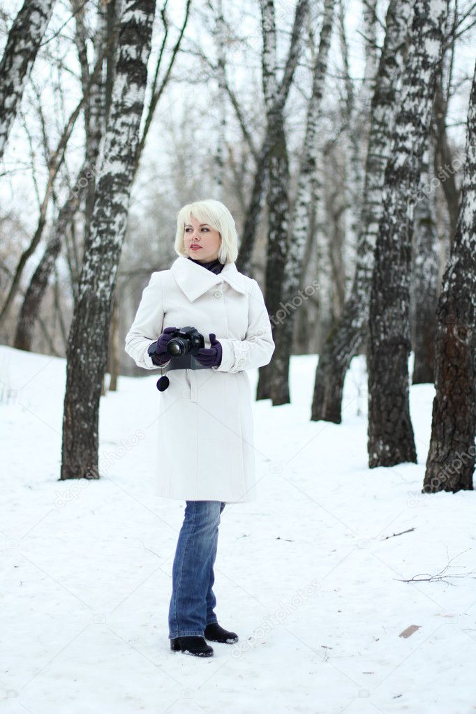Young woman photographer on winter background  — Stock Photo #5261572