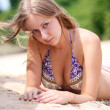 Young woman wearing a bikini is standing at the beach - Foto de Stock