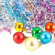 Christmas balls and varicoloured tinsel - Stock Photo