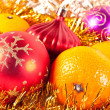 Christmas toy and tangerine — Stockfoto #4299685