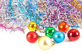 Christmas balls and varicoloured tinsel — Stock Photo