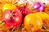 Christmas toy and tangerine — Stock Photo