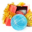 Gift box and christmas baubles — Stock Photo