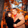 Stock Photo: Young happy couple in autumn park