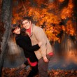 Young happy couple in autumn park — Stock Photo #4147025