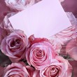 A bouquet of pink roses with a greeting card — Stock Photo #4461950