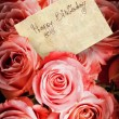 A bouquet of pink roses with a greeting card — Stock Photo #4461956