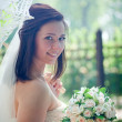 Bride portrait with lacy umbrella — Stock Photo