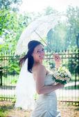 Bride portrait with lacy umbrella — Stock Photo