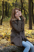 Girl talking on a mobile phone — Стоковое фото