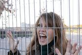 Woman behind bars — Stock Photo