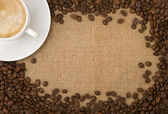 Coffee beans as a frame, and a cup of coffee — Stock Photo
