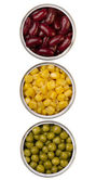 Canned beans, peas and maize in metal cans — Stock Photo