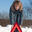 Woman with a warning triangle — Stock Photo