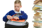 Young boy packing his school bag — Стоковое фото