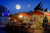 Christmas Market with full moon and illuminated tree at night — Stock Photo