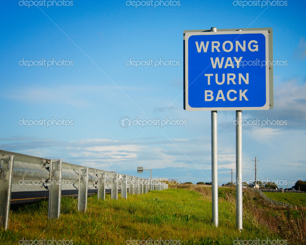 Road  sign ' Wrong Way' and blue sky with clouds — Stock Photo #4662156