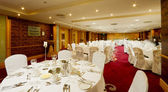 Hotel Hall interior with round tables — Stock Photo