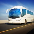 Bus in motion on the highway — Stock Photo