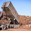Truck unloading metal scrap — Stock Photo