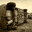 Stock Photo: Cars turned upside-down, sepia