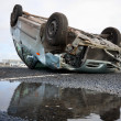 Stock Photo: Car turned upside-down