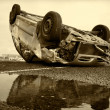 Car turned upside-down, sepia — Stock Photo