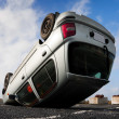 Car turned upside-down - Stock Photo