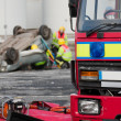 Fire and Rescue service staff at car crash — Stock Photo