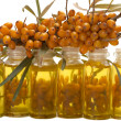 Oil of sea-buckthorn berries. — Stock Photo