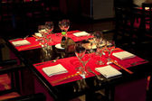 Restaurant table set awaiting guests — Stock Photo