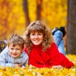 Mother with son in the autumn park — Stock Photo #3942797