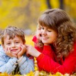 Mother with son in the autumn park — Stock Photo #3942821