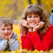 Mother with son in the autumn park — Stock Photo #3942829