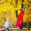 Child and mother with autumn leaves — Stock Photo #4054993