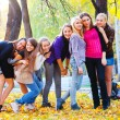 Many young girls in the park - Stock Photo