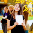 Many students in the autumn park — Stock Photo