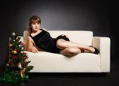 Beautiful woman lying on the sofa — Stock Photo