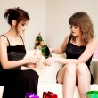 Two women celebrate christmas - Stock Photo