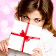 Beautiful woman with gift — Stock Photo #4649327