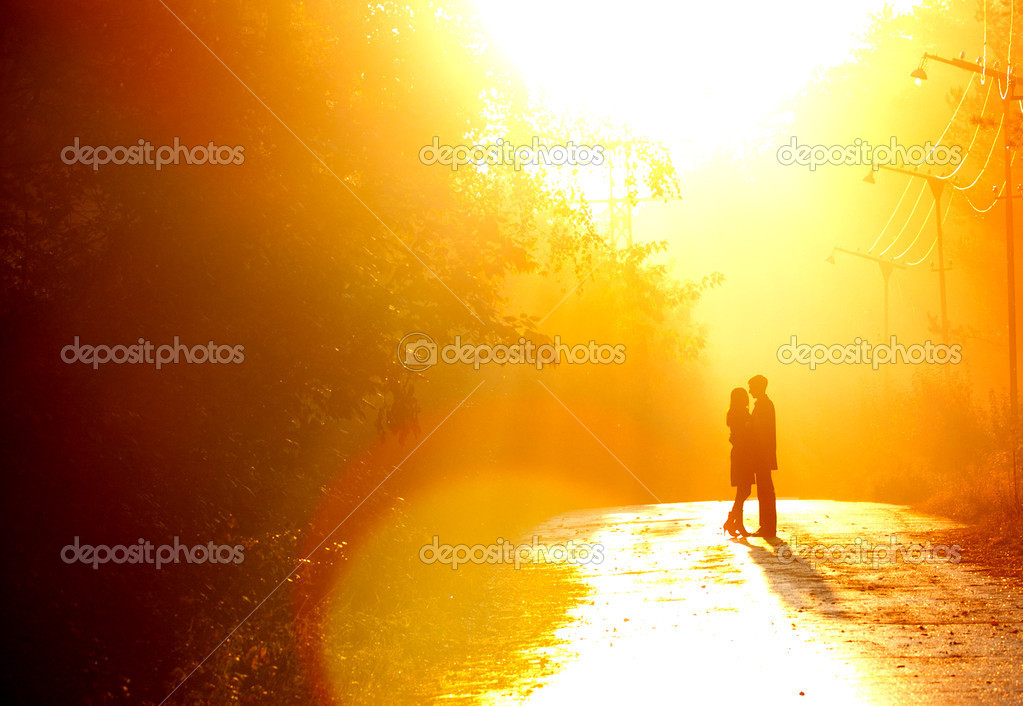 Beautiful shot of kissing couple in the sunlight  Stock Photo #4649386