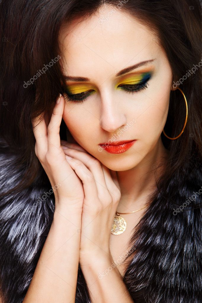 Beautiful woman with bright make-up on black background — Stock Photo #5363284