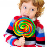 Portrait of girl with lollipop — Stock Photo #4370424