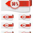 Stock Vector: Red discount labels bent around paper.
